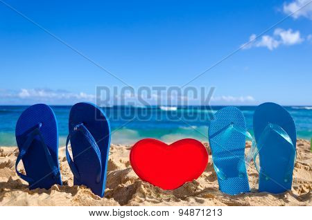 Flip Flops With Heart Shape On The Sandy Beach