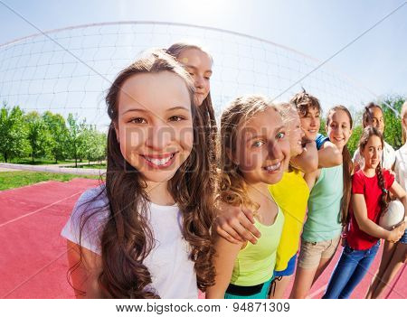 Fisheye view of teens standing in the row on court