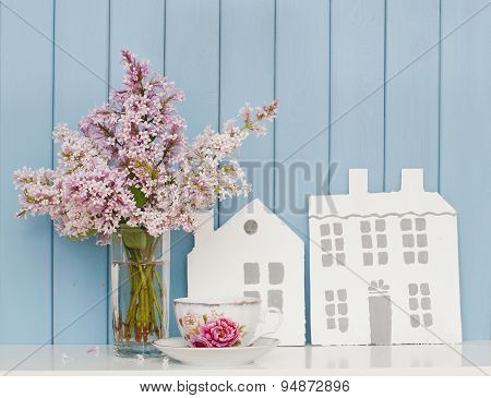 Wooden Houses, China Teacup And Bunch Of Lilac