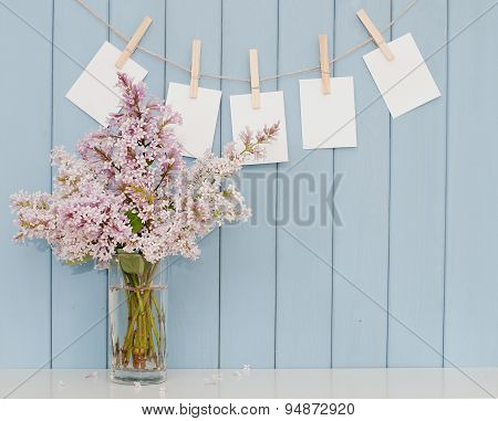 Photographs On The Clothespin And Bunch Of Lilac