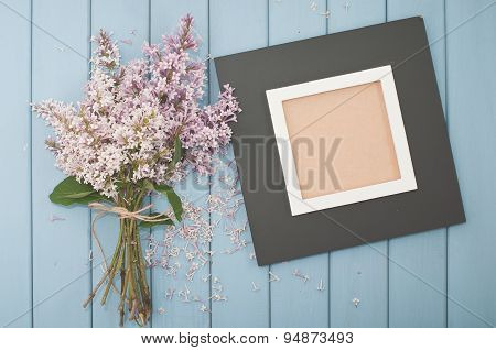 Black Wooden Frame And Flowers