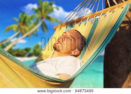 Young Man Relaxing Hanging Chair