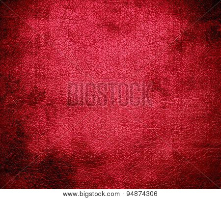Grunge background of amaranth leather texture