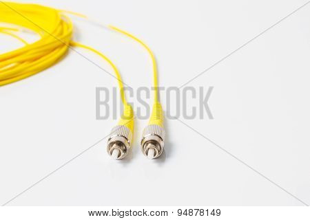 Close up of a fiber optic patchcord on white background