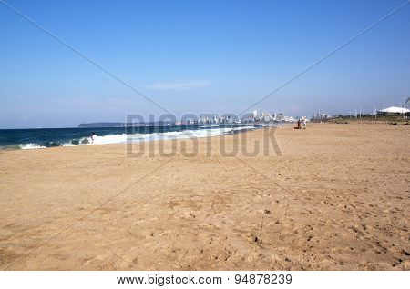 Durban Beach With City Buildings And Bluff Visible In Background