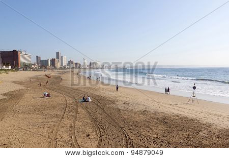 Morning Tyre Tracks And People On Beach In Durban