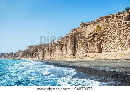 Beautiful Beach With Volcanic Mountains, Turquoise Water And Black Sand
