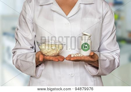 Young Doctor Holding Curd And Bottle Of Pills With Vitamins And