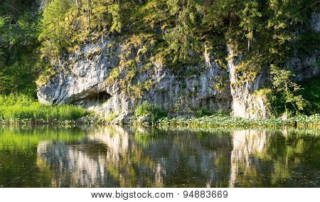 Calm River And Rock Bank