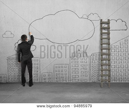 Businessman Drawing Clouds With Copy Space On Concrete Wall