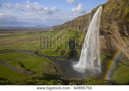 Seljalandsfoss Waterfall With The Rainbow