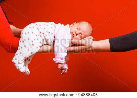 Newborn Baby Girl In The Comfort Of Moms Arms
