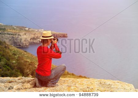 tourist making photo of scenic view while travel