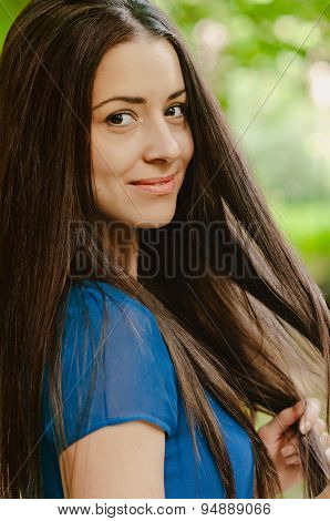 Young beautiful caucasian female with long dark hair