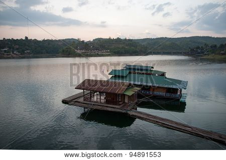 Floating House And Houseboat On The River