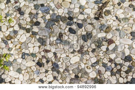 background texture walkway lined with small  stones