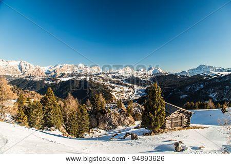 Alpine Hut In A Winter Day
