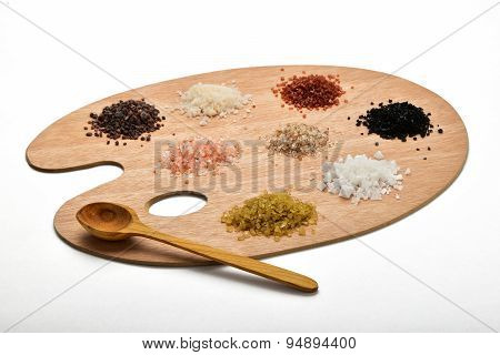 Collection Of Various Salts On Wooden Palette Isolated On White