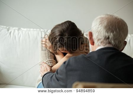 Grandpa Comforting His Crying Granddaughter