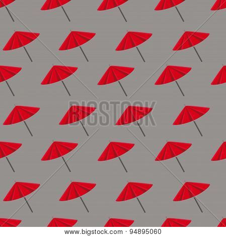 Seamless pattern. Red umbrellas on a gray background