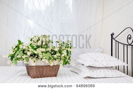 Jasmine Flowers In A Basket On A Bed