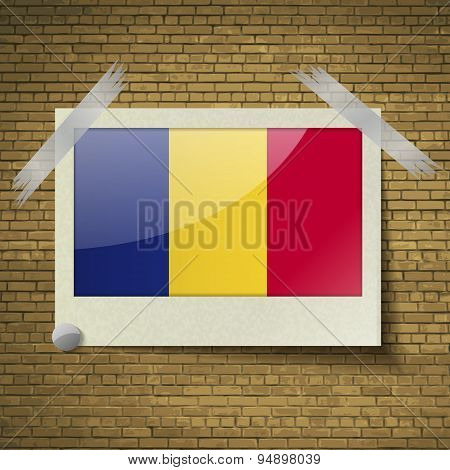 Flags Romaniaat Frame On A Brick Background. Vector
