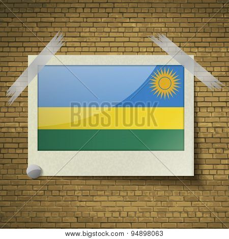 Flags Rwandaat Frame On A Brick Background. Vector