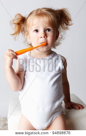 Cute Baby Girl Brushing Her Teeth