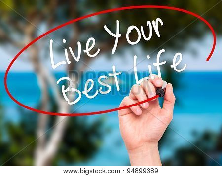 Man Hand writing Live Your Best Life with black marker on visual screen.