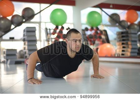 Young Man Doing Pushups At Gym
