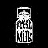 stock photo of white-milk  - White scratched milk can on black background with text inside fresh milk - JPG