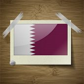 picture of qatar  - Flags of Qatar at frame on wooden texture - JPG