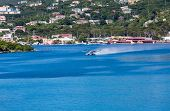 picture of hydroplanes  - A seaplane taking off in blue harbor of St Thomas - JPG