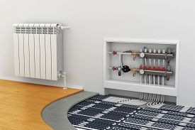 stock photo of electricity meter  - floor heating system the collector the battery - JPG