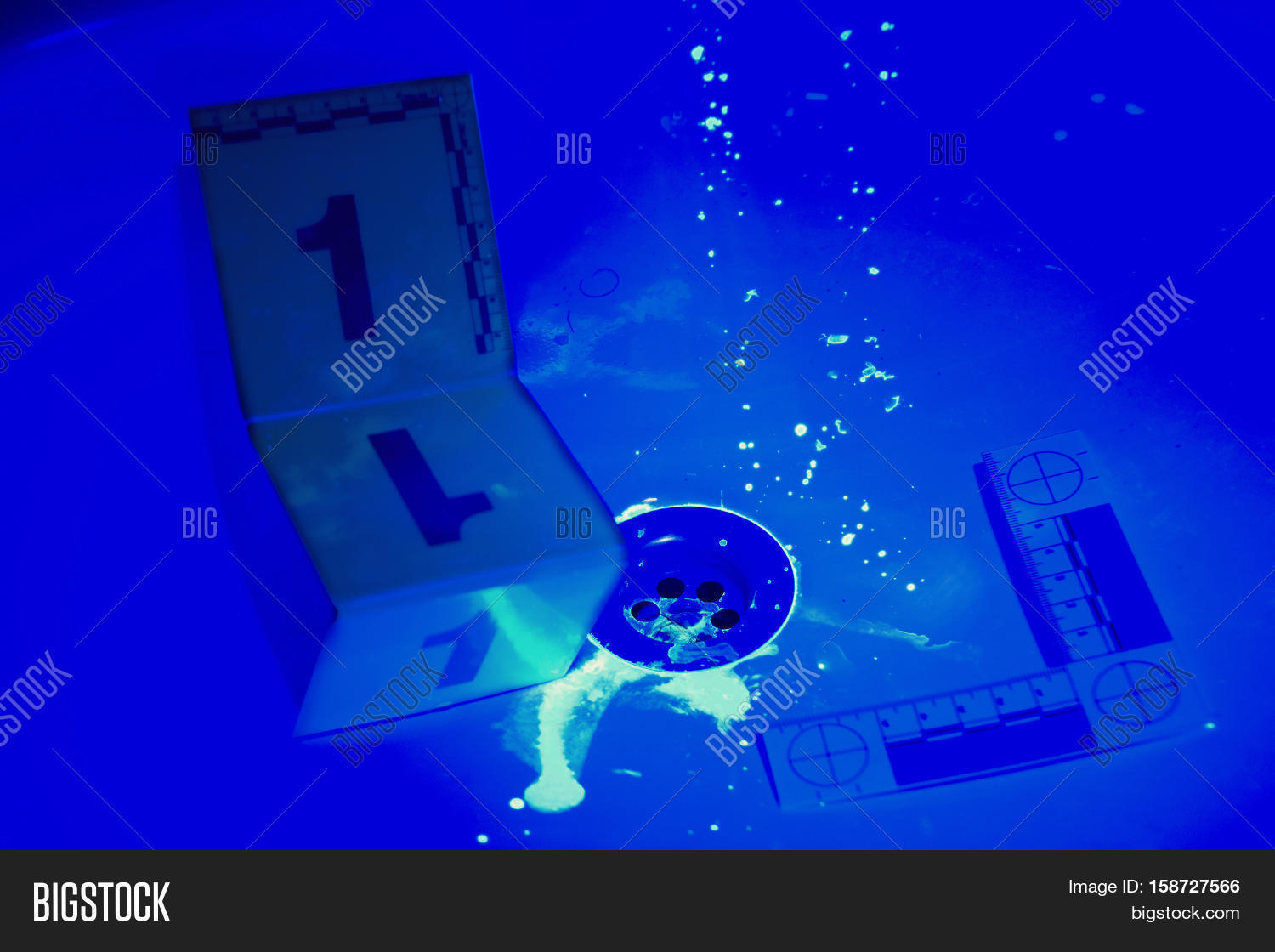 Bathroom Under Light collecting of evidences under uv light in bathroom stock photo