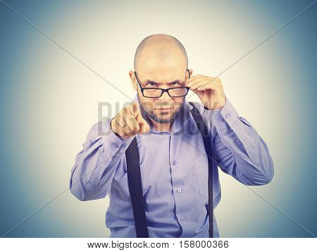 Businessman Looking Over Glasses