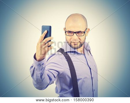 Happy Bald Young Man Taking A Selfie Photo.
