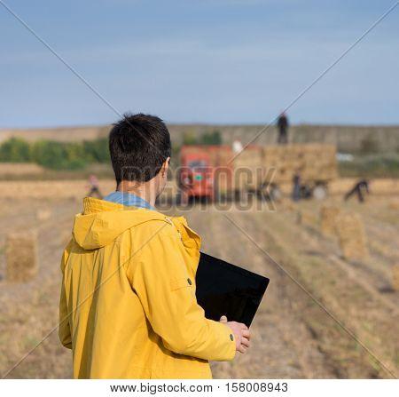 Farmer In Field During Baling