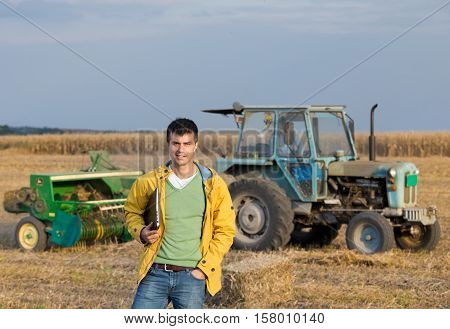 Farmer In Field During Baling