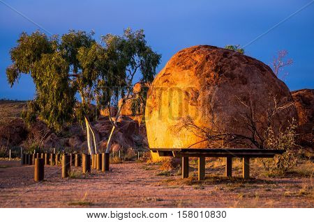 Devil's Marbles is a famous formation of round rocks in the Australian Outback and visited by many tourists on their way to the red centre. In the morning the rocks turn into beautiful orange colour.