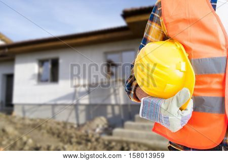 Builder With Protection Equipment Holding Hardhat