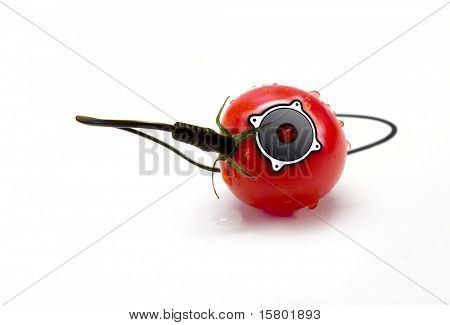 Isolated tomato with build in speaker on white background.