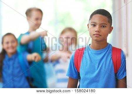 Sad African American boy in school