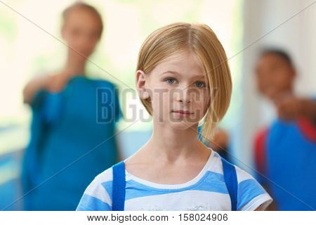 Sad girl in school hallway