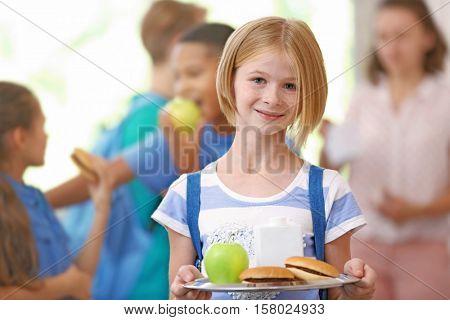 Cute girl eating at school