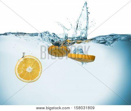 Fresh Orange Slices In Water