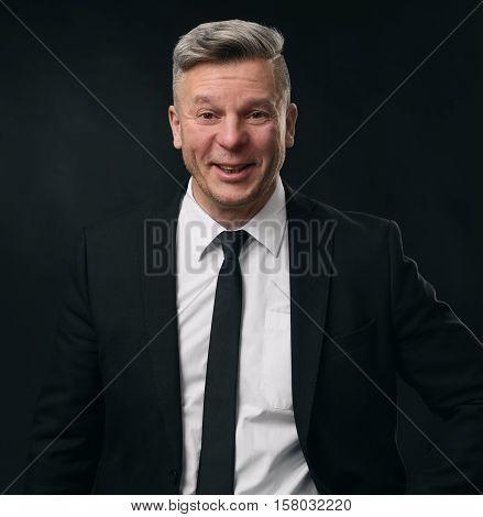 Portrait Of A Confident Mature Businessman Smiling