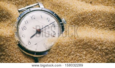 Old Watch Buried In Sand