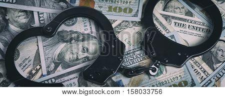 Handcuffs On Money. Us Dollars