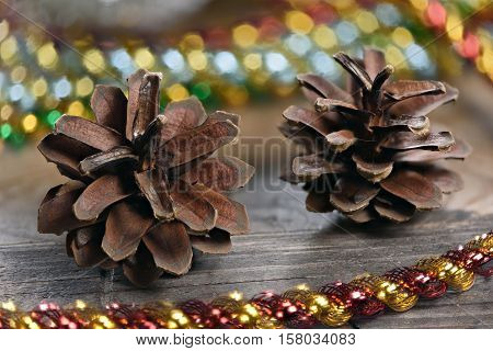Christmas Decoration With Lights And Fir Cones